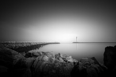 Ostend Bay (lja_photo) Tags: bay ostend oostend monochrome monotone monoart moody rocks travel tourism tower radar sea seashore seascape ocean seaside sealine long exposure longexposure exploration dramatic landscape light landmark water contrast black white blackandwhite bw bnw blackandwhitephoto photography belgium fine art artificial harbor europe lights sky reflections street