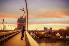 Standing on the Bridge (Marc Braner) Tags: ifttt 500px city sunset river clouds tower cityscape bridge man person germany skyline cathedral colorful dusk promenade street light standing dramatic sky rhine worms building exterior arch nibelungenbrücke rhinelandpalatinate nibelungenturm