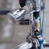 Victoria (suzanne~) Tags: bike bicycle headbadge logo light lamp headtube project detail 100bicycles lensbaby composerpro sweet80 victoria