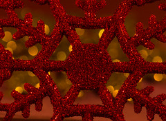 Red On Yellow, Ornaments By Candlelight (gleavesm) Tags: bokeh candlelight macro ornament snowflake christmas red yellow