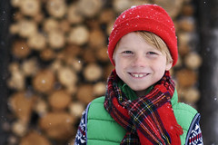 Warm smile (Elizabeth Sallee Bauer) Tags: christmas boy child childhood cold coldweather colorful copyspace festive holiday kid outdoors outside red seasonal snow snowing white winter youth