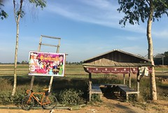 Myanmar, Ayeyarwady Region, Hinthada District, Hinthada Township, Myo Kwin Village Tract (Die Welt, wie ich sie vorfand) Tags: myanmar burma ayeyarwadyregion ayeyarwady irrawaddy hinthadadistrict hinthada bicycle cycling surly crosscheck busstop busshelter advert advertising poster entertainment hinthadatownship myokwin highclass