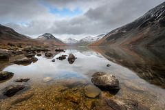 Calm before the storm (Pete Rowbottom, Wigan, UK) Tags: wastwater lakedistrictnationalpark landscape cumbria lake mountain dramatic clouds water rocks wainwright reflection wideangle weather lakes beautiful england uklandscape waterreflections peterowbottom yellow red blue nature light winter christmas thescrees hills mountains snow ice nikond750 sky yewbarrow greatgable greengable noel xmas natural outdoor britain art snowcapped orange geotagged