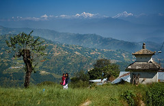 Newari girl carrying baby in front of Himalaya Range, Dulikhel, Katmandu Valley, Nepal (Alex_Saurel) Tags: tree landscape nepaligirl snowcappedmountains paysage vallées himalayarange gyaltsenpeak asie culture dorjelakpa 35mmprint roof phurbichyachu scans chaînehimmalayenne neige lönpogang asian chemin path valley stupa walking marcher people houses himalaya asia mountainrange montagne architecture summit travel bébé vert imagetype baby photospecs photoreport mountain photoreportage beautiful gurung mother reportage summits portrait photojournalism stockcategories nature day green matin bluesky traditional langtanglirung time morning tradition woman traditionnalclothes nepal newari lifestyles arbre sony50mmf14sal50f14