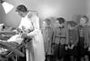 Don't Scream (theirhistory) Tags: dentist children girls chair lamop teeth examination jacket skirt