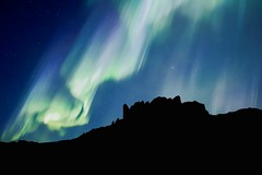 Blue Night Sky Aurora Borealis Activity Above a Rocky Mountain Top (Cole Eaton Photography) Tags: magnetic silhouettes silhouette northern iceland aurora mountain borealis sky landscape green winter norway nature light night space snow astronomy cold lagoon water beautiful travel polar background over glacier natural blue universe star dramatic solar magical color scandinavia dark beauty outdoors phenomenon north arctic