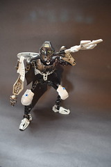 Numakha, Warrior of Earth (Harding Co.) Tags: lego figure bionicle moc kanohi mask warrior ancient earth air jungle ice cape flying shield sword axe wings black grey silver white blue