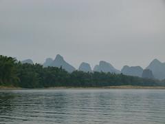 Karst Hills Along River Li (Toats Master) Tags: yangshuo china riverli rafts bamboo pvc water river raft karst countryside