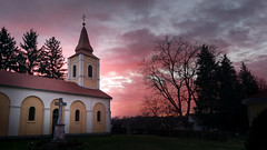 Winter dusk (!vanM) Tags: dusk winter slatina croatia light sunlight sunset blue hour church sky red purple sun clouds christmas pink orange old garden trees building smartphone htc htc10
