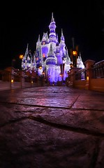 The road to the Christmas Castle (Matt Straite Photography) Tags: disney disneyworld magic magickingdom florida orlando vacat cavation castle fantasy color christmas street stone cobble lights night dark fish fisheye low pov blend photoshop lightroom landscape