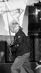 Shoreline of Infinity night December 2017 010 (byronv2) Tags: shorelineofinfinity literature sciencefiction frankensteins frankensteinsbierkeller stage writer author scotland edinburgh edinburghbynight night nuit nacht peoplewatching candid georgeivbridge edimbourg blackandwhite blackwhite bw monochrome fencing sword duel dueling longsword medievalsword
