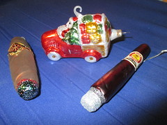 Santa Delivery Car with Two Cigars 2017 NYC 5400A (Brechtbug) Tags: santa delivery car with two cigars christmas ornaments glass holiday ornament packages presents display profile snow face portrait reflection lights holidays decoration decorations decor night lites light oversize load ball balls xmas claus st nick saint nicholas truck driving drive automobile cars deliveries 2017 nyc