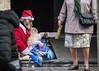 Crisis (Lara Santaella) Tags: streetphoto streetphotography beggar panhandler santaclaus christmas homeless