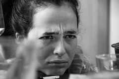Grumpy. Things don't always go as you want. (Phototravelography) Tags: germany layla munich portrait xmas blackandwhite expression expressive frown girl glasses grim grumpy lady portraitphotography sinister table woman ngc münchen