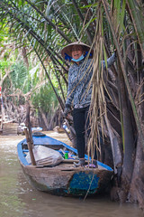 Vietnamese woman in boat (Phil Bagnall) Tags: boat asia blue cone hat mekong paddle river vietnam water woman