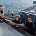 Sailors load forward closed-in weapons system to prepare for a live-fire exercise during deployment on the USS America