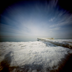 Maple St Beach Pinhole [2] (jwbeatty) Tags: 120 analog ektar100 film filmisnotdead frozen ice illinois ishootfilm kodak lakemichigan lensless mediumformat pier pinhole realitysosubtle6x6 shadow snow winnetka winter