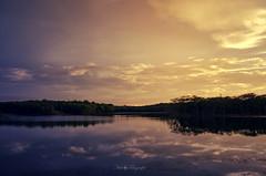 Colorful...!!! (Nita_Fotos) Tags: sun sundown clouds blue orange sol atardecer nubes naranja cielo mountain montañas reflection reflejos trees arboles agua backligh contraluz lecheria venezuela tuniñasalvajedelaselva