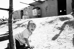 The cry of war (Giulio Magnifico) Tags: syria 28mm iraq refugees mosul da3sh kurdistan iraqi deepsoul desperate yazidi destroyed iraqturchia littlegirl desert kurdish refugeescamp blackandwhite candid leicaq middleeast civilwar cry leica child