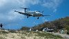 Tradewind Approach (Ben_Senior) Tags: stbarts stbarthélemy caribbean island tropical tropics paradise airport airplane plane airliner airline aircraft aviation turboprop pilatus pc12 tradewind tradewindaviation ttail bensenior planespotting nikon d7100 nikond7100 runway approach landing steep hill green trees mountain mountains hills colorful colourful pt6 n524tw