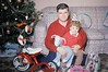 """Yay! My very first vehicle. Thanks, Santa! Dad holds me while mom takes the photo. His camera had no flash, so this Kodachrome slide was taken with really bright """"photoflood"""" lights that he also used in home movies. Milford Connecticut. Dec 25 1960 (wavz13) Tags: oldphotographs oldphotos 1960sphotographs 1960sphotos oldphotography 1960sphotography vintagesnapshots oldsnapshots vintagephotographs vintagephotos vintagephotography filmphotos filmphotography family familyphotos familyphotography oldfamilyphotos oldfamilyphotography vintagefamilyphotos vintagefamilyphotography vintagemilford oldmilford 1960smilford vintagewoodmont oldwoodmont 1960swoodmont vintagenewengland oldnewengland 1960snewengland vintagenewenglandphotography oldnewenglandphotography vintage35mm old35mm vintagekodachrome oldkodachrome oldslides vintageslides vintagechristmas oldchristmas vintagebicycles antiquebicycles collectablebicycles collectiblebicycles oldtoys antiquetoys"""