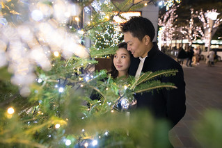 Young wife and husband looking at Christmas tree in capital city