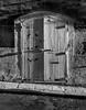Nameless (kurjuz) Tags: malta saintursulastreet sidelit valletta blackandwhite door garage longshadows lowsun nonumber stone wood