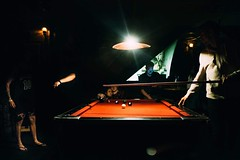 Guys around a pool table in Queenstown (Giacomo Vesprini) Tags: queenstown newzealand colors giacomovesprini eyegobananas x100s fujifilm street streetphotography