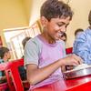 happy about breakfast (Pejasar) Tags: boy breakfast rice beans smile faithcommunityschoolandchildrenshome clementtown dehradun india