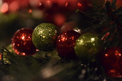 All that glisters... (Bad Alley (Cat)) Tags: ornament christmas christmasornament christmastree holiday xmas merrychristmas seasonsgreetings happyholidays glitter garland sparkle red green decoration bokeh