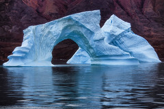arched iceberg in Greenland (yan08865) Tags: iceberg water rock greenland sailing sail boats ice flow landscapes sea ocean seascapes pavlis nature earth scoresbysund rypefjord harefjord fønfjord constable point