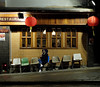"""""""are you coming?"""" (hugo poon - one day in my life) Tags: xt20 23mmf2 hongkong saiyingpun queensroadwest restaurant citynight winter cold rainy solitude waiting empty dinner phone dark wet colours lights saturday"""
