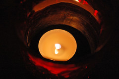 Tealight Candle. (dccradio) Tags: lumberton nc northcarolina robesoncounty indoors inside candle candles burning illuminated flame redcandleholder candleholder tealightcandle jarcandle dark fire nikon d40 dslr circle round tealight red light candlelight