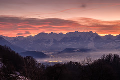 sunset behind swiss mountains (felipeepu) Tags: nature elements earth sun sky clouds fog trees colorful mountains firmament stars moon snow