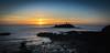 Godrevey sunset (paullangton) Tags: cornwall seascape blue red rocks beach lighthouse canon bird seagull