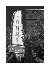 Johns Apparel (DJ Wolfman) Tags: signs oklahoma poncacity blackandwhite bw old oldbuildings art olympus olympusomd em1markii 12100mmf4zuiko zuiko zd micro43