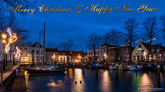 Happy holidays and happy new year (BraCom (Bram)) Tags: 169 bracom bramvanbroekhoven christmas goereeoverflakkee jacht kerst middelharnis blauweuur bluehour boat boom harbor haven house huis jetty kade lantaren lantern lights marina mast masts meerpaal mooring morning ochtend quay reflection sailboat spiegeling star steiger ster tree verlichting water widescreen yacht zuidholland nederland nl