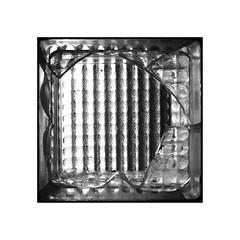 broken glass (chrisinplymouth) Tags: glass brick broken monochrome square cw69sq black white cw69x brokenglass 01 2017 inexplore explored