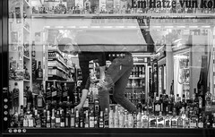 happy Sylvester and cheers ! (ThorstenKoch) Tags: street streetphotography stadt strasse schatten shadow schwarzweiss city candit cologne köln kiosk drinks happynewyear sylvester party monochrome man window shop pov photography people photographer picture germany urban fuji fujifilm thorstenkoch