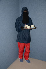 Slave waitress in rainwear (Warm Clothes Fetish) Tags: maid slave sweat torture girl niqab hijab burka chador apron boots anorak warm hot fur fleece