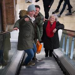 Escalator moment (paul indigo) Tags: colour escalator fun gesture laughter mall people shopping square travel