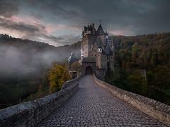 Eltz Castle (v-_-v) Tags: wierschem rheinlandpfalz deutschland de eltz burg castle mist fog cloud autumn germany europe travel sky trees forest bridge
