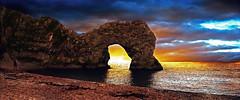 Durdle Door Dorset 2 (andycurrey2) Tags: sunset colours sea ocean sky clouds beach dorset rock stone water