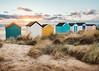 Southwold beach huts. Sunrise. (garethottywill) Tags: xt2 fujinon16mmf14 sky colourful clouds sunrise early sand beachhuts