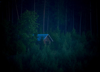 Cabin in the nighttime woods
