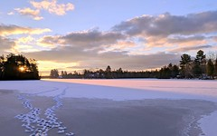Footprints toward a rosy sunrise (yooperann) Tags: frozen bass lake forsyth township upper peninsula michigan footsteps sunrise pink clouds snow