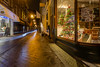 Eerie Trail (graemea00) Tags: papestraat donutsandco filtrokoffie thehague denhaag nederlands netherlands thisisthehague thisisholland holland southholland street night nighttime city centre shops shiny cold winter longexposure canon6d canon canon1740mm tripod bicylce lights lighttrail