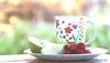 Afternoon tea ...006/365 (judith511) Tags: afternoontea apple raspberry tea cup mug bokeh outdoortable garden 2018onephotoeachday