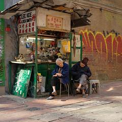 """lifelong partners"" (hugo poon - one day in my life) Tags: x100f hongkong sheungwan desvoeuxroad lifelongpartners couple aged vanishing locksmith leekee colours winter light graffiti nap sunny two partners companions"