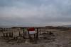 Red and White. Bombay Beach. Salton Sea. California. (PickledMonkeyStudio) Tags: sea saltonsea water abandoned ruins bombaybeach california desolation clouds